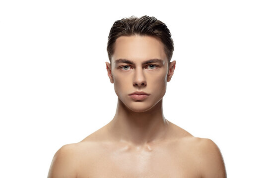 Anger. Portrait of young man isolated on white studio background. Caucasian attractive male model. Concept of fashion and beauty, self-care, body and skin care. Handsome boy with well-kept skin.