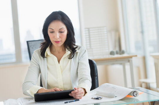 Architect working on digital tablet in office