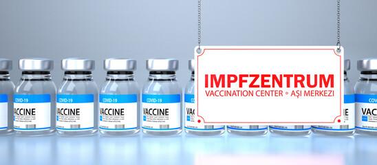 Impfdosen mit Schild Impfzentrum