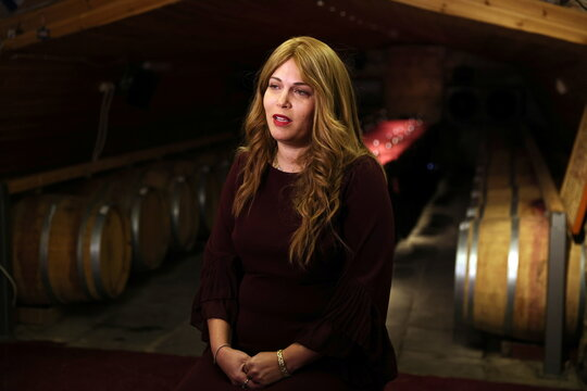 Vered Ben-Sa'adon, the owner of Tura Winery, speaks during her interview with Reuters at the winery in Rehelim, an Israeli settlement in the occupied-West Bank