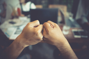 Cropped Image Of Colleagues Giving Fist Bump - fototapety na wymiar