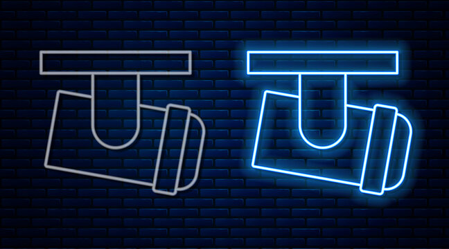 Glowing neon line Led track lights and lamps with spotlights icon isolated on brick wall background. Vector.