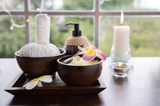 View of Spa Treatment Set with Massage oil and Sea Salt on and Herbal Compress Ball