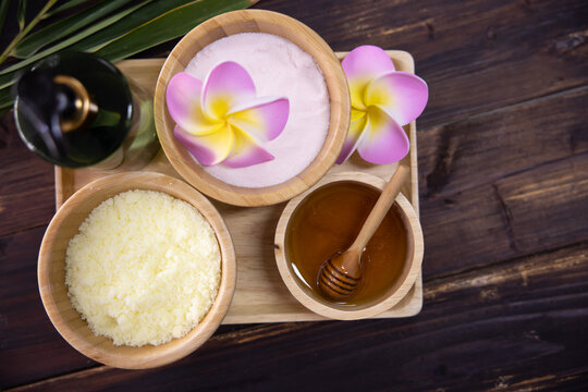 View of Spa Treatment Set with Massage Oil  Sea Salt and Honey on the Wooden Table