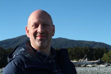 Fototapeta Portrait Of Smiling Man Against Clear Blue Sky obraz