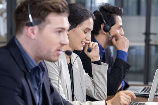 Side View of Telemarketing Operators  with Headset Talking with Their Clients