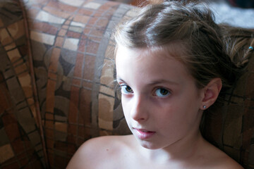 Fototapeta Close-up Portrait Of Shirtless Girl Sitting On Sofa At Home obraz