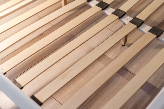 Wooden slats for arthopedic base of double bed. Interior structure of furniture
