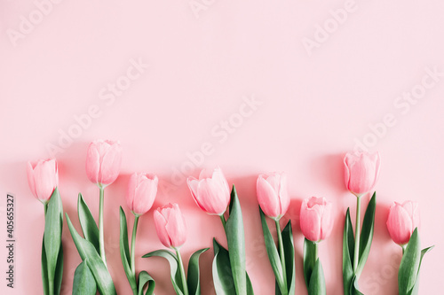 Beautiful composition spring flowers. Bouquet of pink tulips flowers on pastel pink background. Valentine's Day, Easter, Birthday, Happy Women's Day, Mother's Day. Flat lay, top view, copy space