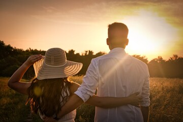 Rear View Of Couple Standing On Field Against Sky During Sunset