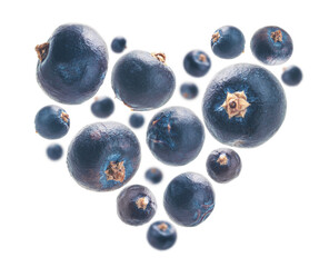 Juniper berries in the shape of a heart on a white background