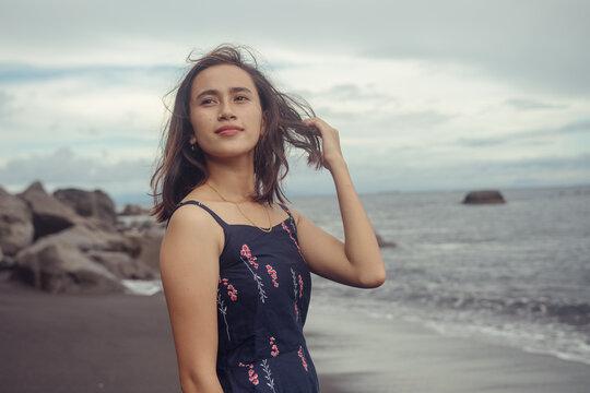 "Beach photoshoot with a beautiful balines girl on the beach ""Pantai bias lantang, Bali"" hair wind."