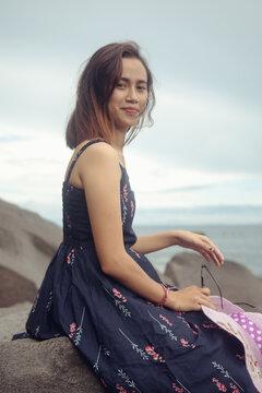 "Beach photoshoot with a beautiful balines girl on the beach ""Pantai bias lantang, Bali"" with fashion hat."