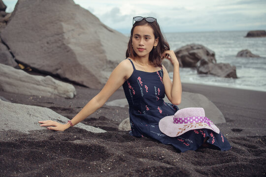"""Beach photoshoot with a beautiful balines girl on the beach """"Pantai bias lantang, Bali"""" with with glasses."""