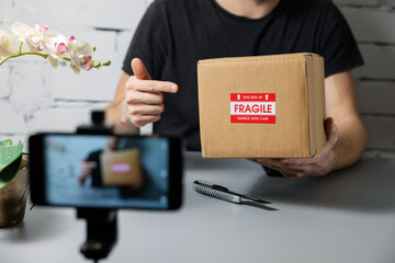 social media influencer recording product unboxing video. online marketing