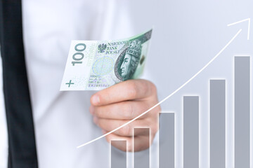 Obraz Koncepcja rozwoju i wzrostu. Biznesmen planuje rozwój i wzrost zysków w swoim biznesie. Sto złotych w dłoni. - fototapety do salonu