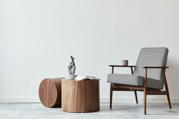 Minimalist composition of scandinavian living room with design armchair, wooden coffee tables, decoration, presonal accessories and copy space in modern home decor. Template.