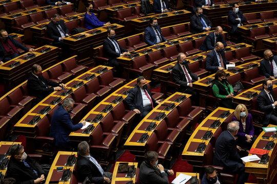 Greek PM Kyriakos Mitsotakis addresses lawmakers on his government's handling of the coronavirus disease (COVID-19) pandemic