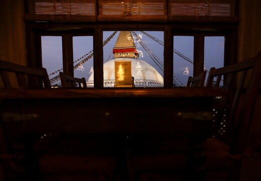 A view of Boudhanath Stupa, a UNESCO's world heritage site famous among Buddhist devotees and tourists, is pictured through the window of a restaurant, in Kathmandu