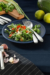 Fresh salad on blue plate and free space for your decoration