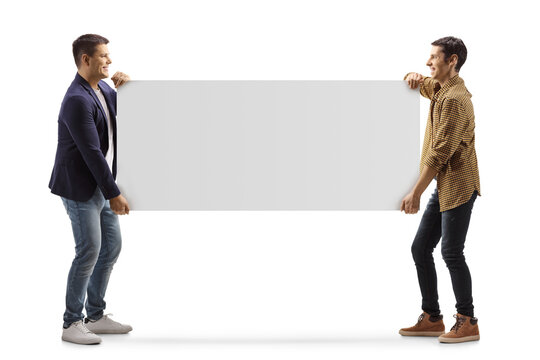Full length profile shot of two casual men carrying a blank panel
