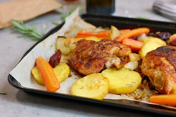Wall Mural - Roasted chicken leg with grilled vegetables potato, carrot, beetroot, onion