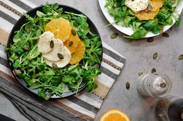 Wall Mural - Fresh salad with lettuce, orange, mozzarella and pumpkin seed