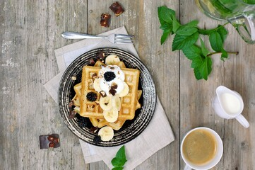 Wall Mural - Whole grain waffles with chocolate, banana, cottage cheese, milk, coffee