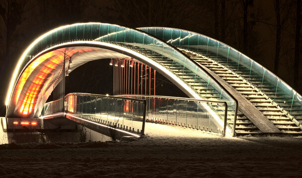 Bridge in the People's Park in Lublin illuminated with LED light - red