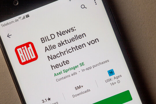 """Neckargemuend, Germany: January 15, 2021: app icon of of the German news magazine """"Bild"""" in the google app store on phone screen top view, Illustrative Editorial."""