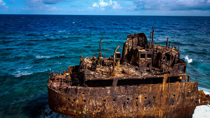 Weathered rusty Caribbean shipwreck on the shore of a Little Curacao Island