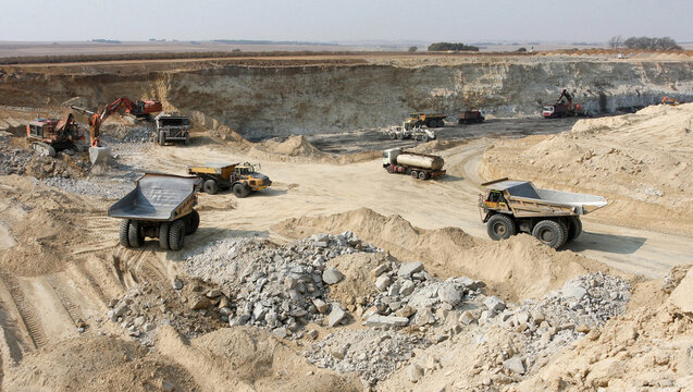 Coal mining open pit with many large trucks for coal transporting in South Africa