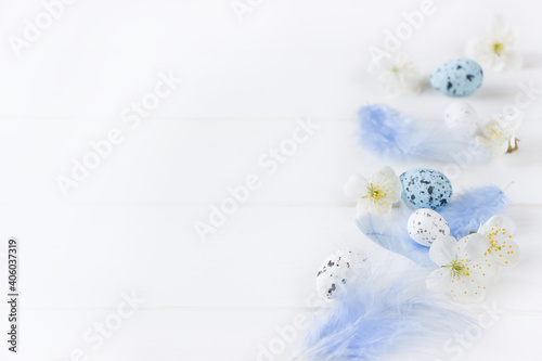 Spring flowers composition and easter eggs on white board, empty space, Creative layout for Mother's day, women's day, 8 march,  easter. Spring flowers  background with copy space