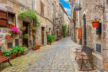 Fototapeta A street in the old historic town of Bolsena, Italy, Europe