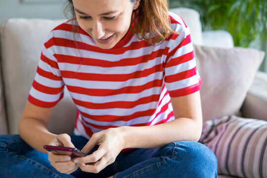 Young woman using phone at home