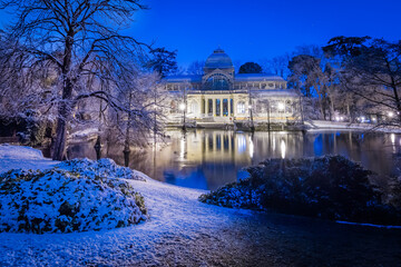 Cityscape of Madrid on a Snowy night at the Retiro Park