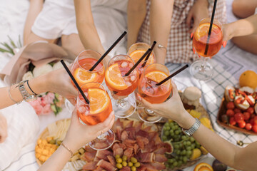 High Angle View Of Friends Toasting Drinks On Table
