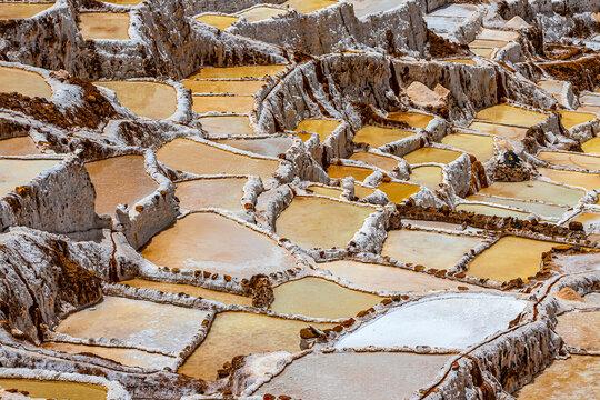 Peru, Cusco Region. Maras, town located in the Sacred Valley. Salt evaporation ponds (Salineras de Maras)