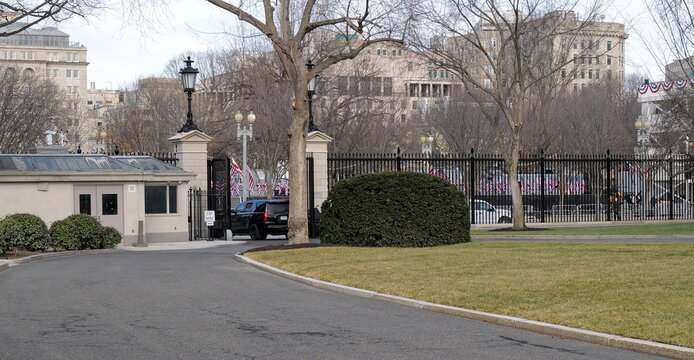 A Secret Service vehicle drives out of the front gate of the White House ahead of U.S. President-elect Joe Biden's inauguration, in Washington
