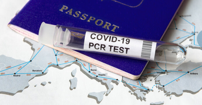 COVID-19, travel and test concept, tube for coronavirus PCR testing and tourist passport on Europe map