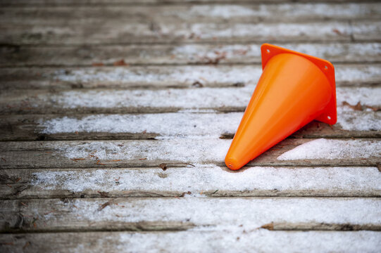 Shot of a small pylon laying on a deck