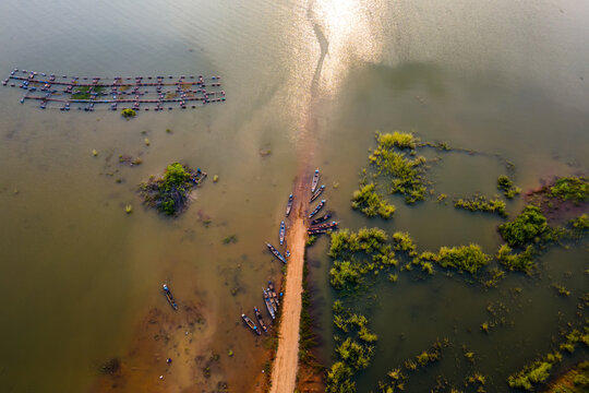 Aerial view Drone top view of Longtail fishing boats in the river.