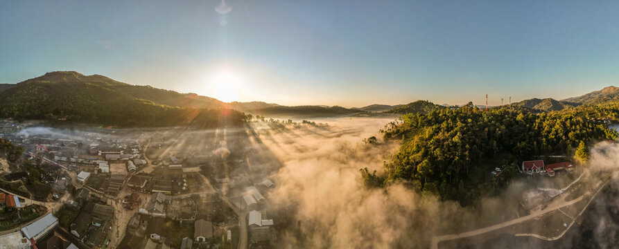 Panorama, Beautiful aerial high angle drone view of Ban Rak Thai Village in sunrise, a Village of Chinese settlement in Mae Hong Son province, Northern Thailand