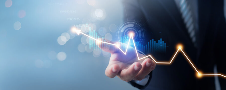 hand of businessman in suit hold banking business finance graph on soft blur blue background and invest in stock market investment point, economic growth and investor concept
