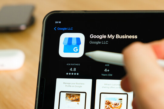 Google My Business logo shown by apple pencil on the iPad Pro tablet screen. Man using application on the tablet. December 2020, San Francisco, USA.