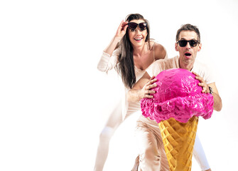 Summer style shot of an attrcative couple holfing huge ice cream