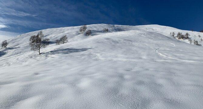 Skiing, Skier, Freeski - Ski trace in the snow with blue sky
