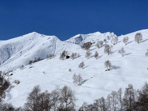 Snowy mountain landscape in italian Alps, Europe.