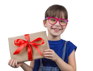 Portrait of an excited young girl in colorful glasses holding present box. Happy child with gift isolated on white background