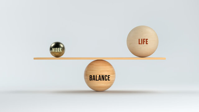 wooden scale balancing spheres with text WORK, LIFE and BALANCE on white background